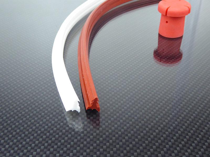 KREMER - Profile aus EPDM weiß und rot