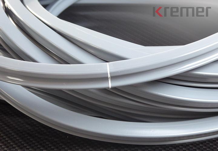 KREMER – Filmvulkanisation von Silikonprofilen zu Ringen und Rahmen